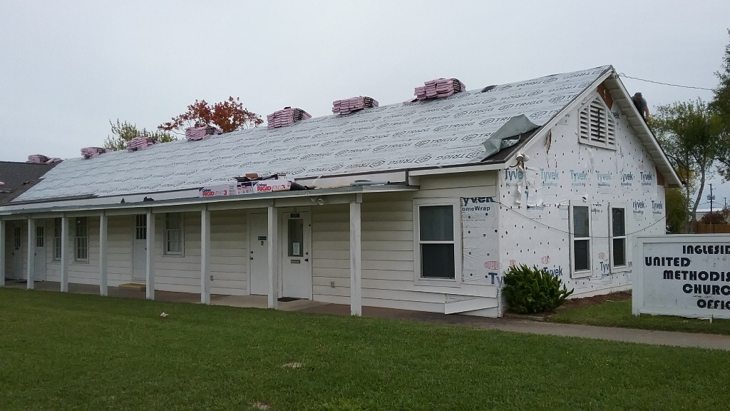 Fellowship Hall and Church receiving a new roof. Siding being replaced on Church Office.