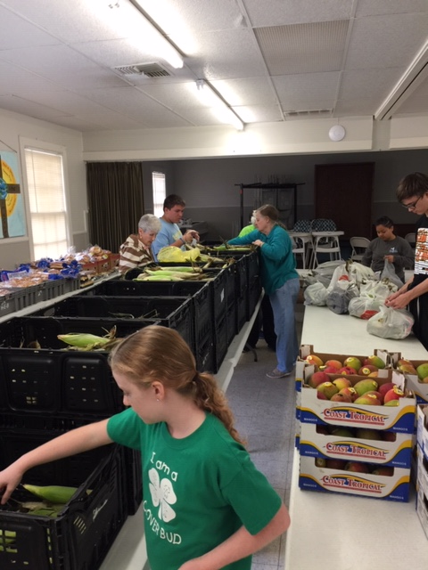 Some of our volunteers and helpers from the High School at work in our Food Pantry.