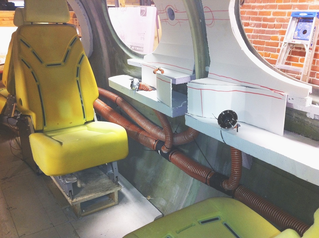 Cabin comfort and systems are evaluated in this fiberglass mockup. Foam core styling panels are roughed in.