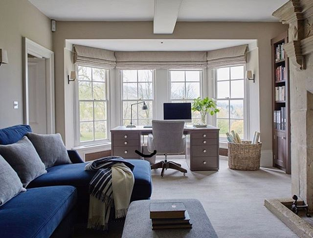 Farrow & Ball 'Pavilion Gray' on the walls and 'London Clay' on the woodwork.