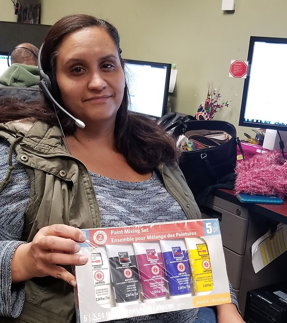 Dimarie Vazquez holding some of the art supplies.