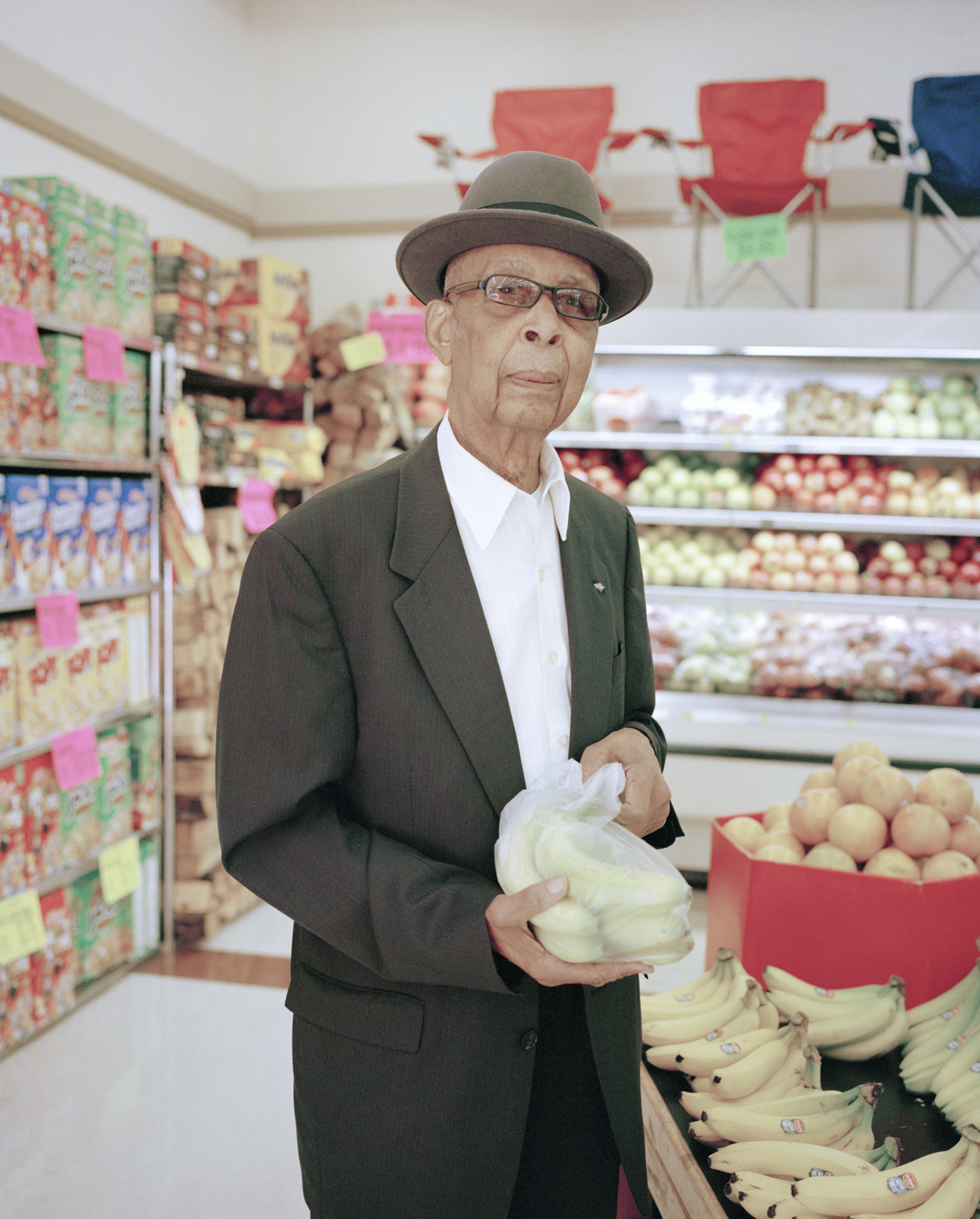 Untitled (Grocery Store Man)  - © Anna Brody