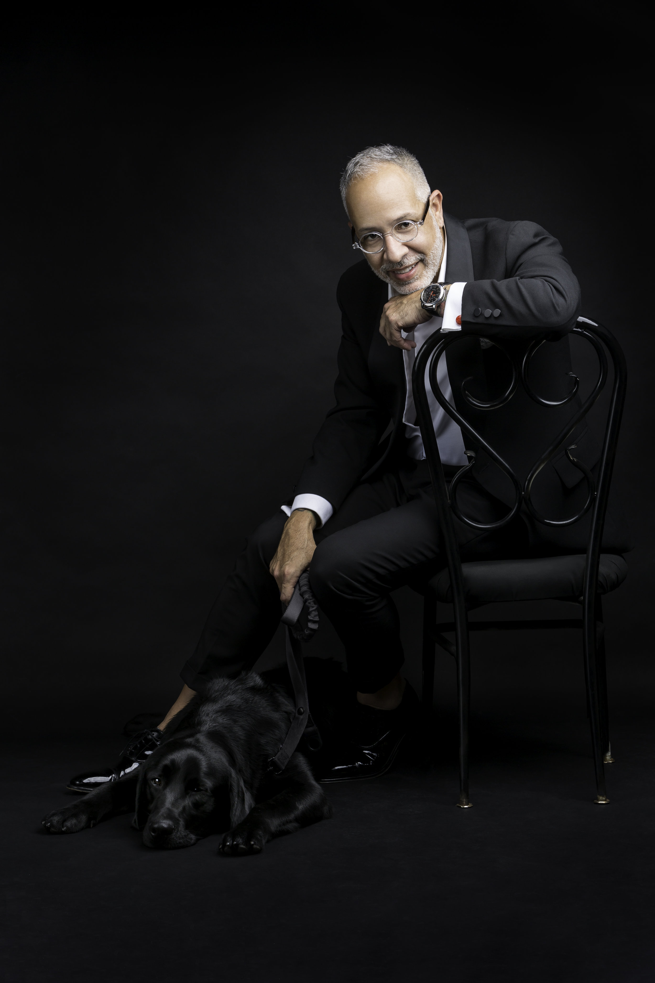 """E. Vincent Martinez pictured with """"puppy Vincent"""" from Canine Assistants. Photo by Tomas Espinoza Photography"""