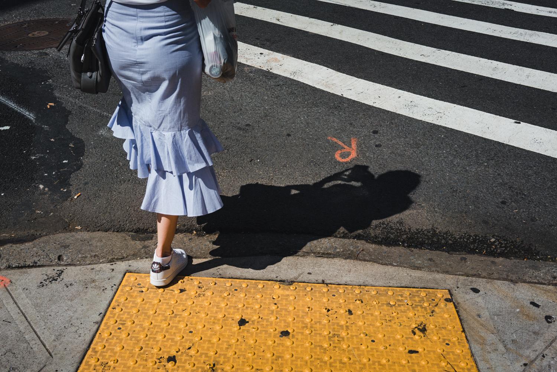 DeniseLaurinaitisNewYorkCityStreetPhotographerBlueSkirtShadowPhone.jpg