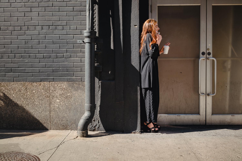 DeniseLaurinaitisNewYorkCityStreetPhotographerWomanSmokingPhone.jpg