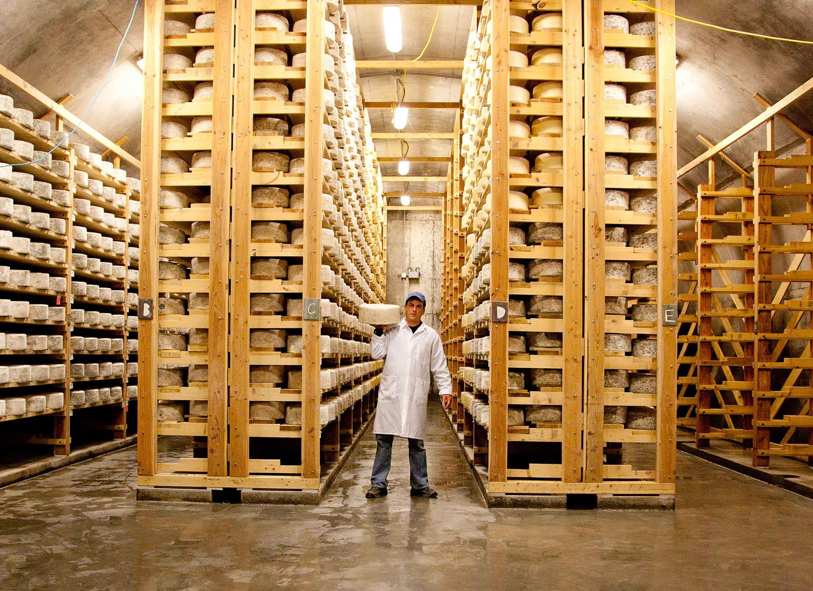 In the cellars at Jasper Hill Farm, cheese from their own creamery and others around the area ripen. The shared space, equipment and collaborative ethos allow many cheesemakers, large and small, to exist in the community.