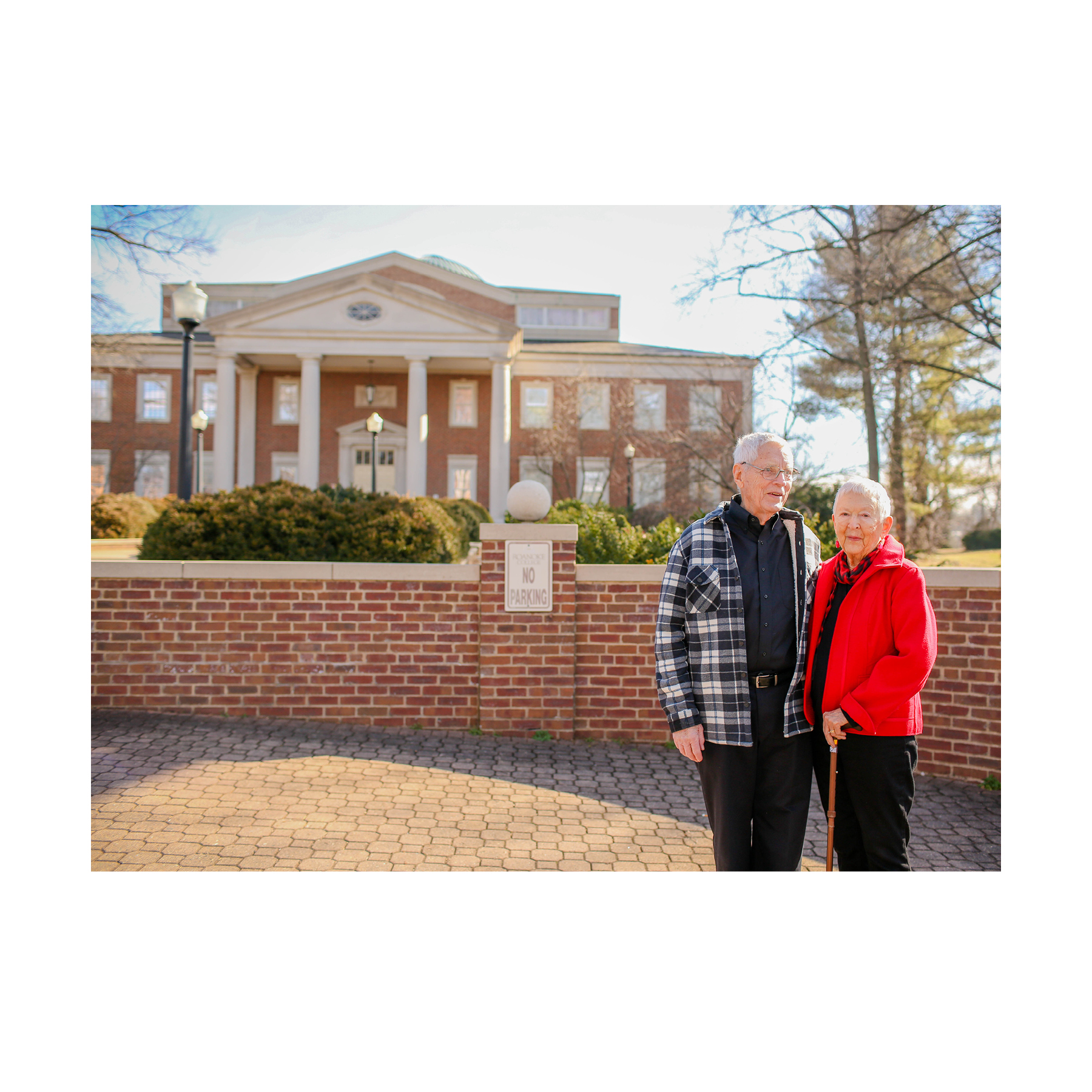 "2013 —Norm and Jo returned ""home"" to the Roanoke Valley, living close to Roanoke College at Brandon Oaks Retirement Community. Here, they stand on campus in front of the Fintel Library, named in their honor.  (photo courtesy of Roanoke College)"