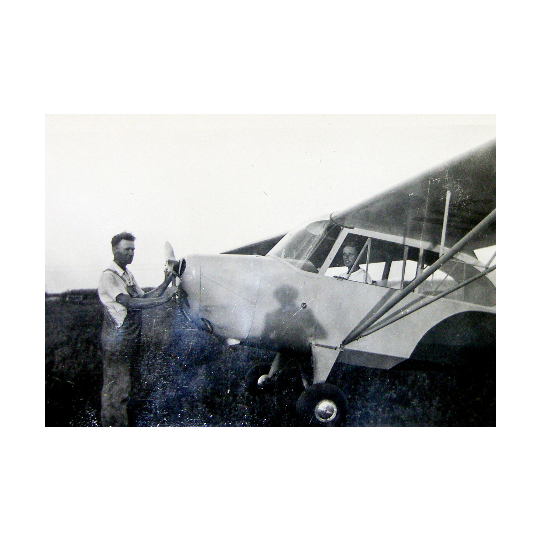 July 4, 1946 —Norm (seated) and his father with the airplane won in a raffle at the age of twenty-one.