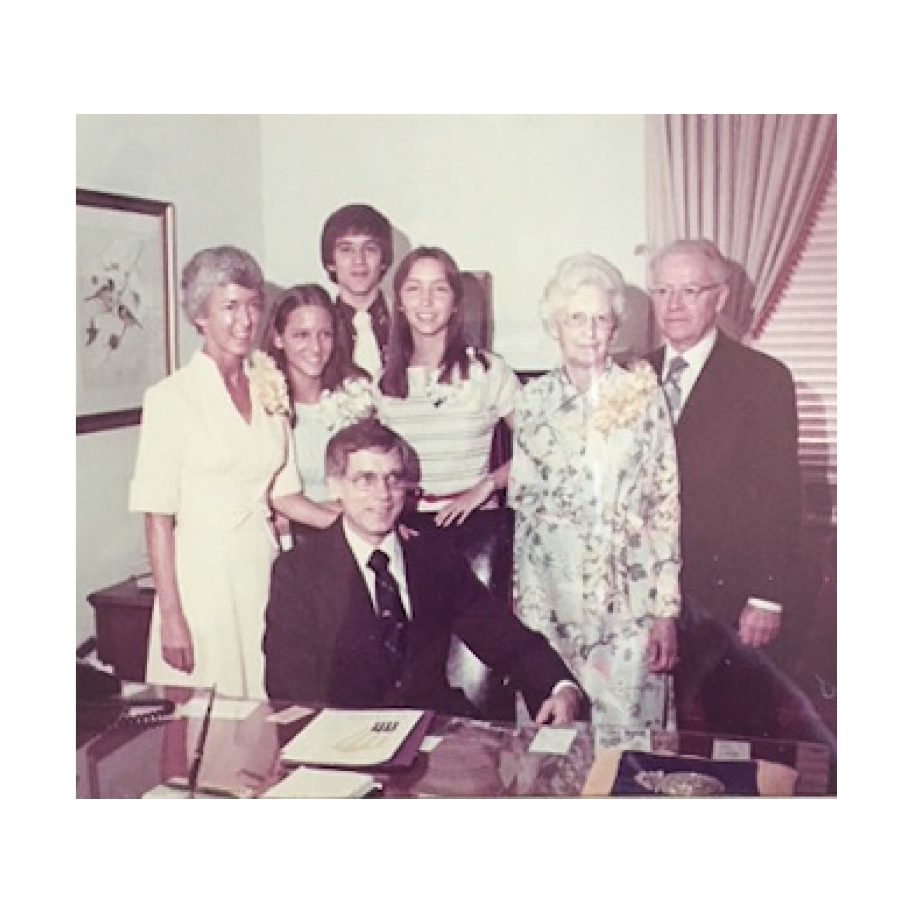 1975 —Dr. Norm Fintel became president of Roanoke College, three years after completing his Ph.D. in Higher Education. The Fintel family is shown here, with Norm seated at his desk, and his parents to the right.  (photo courtesy of Roanoke College)
