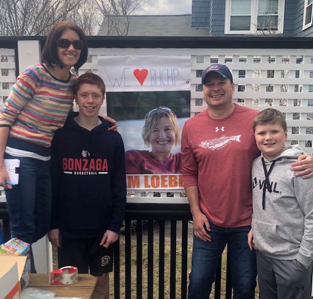 family with Loeber sign.JPG