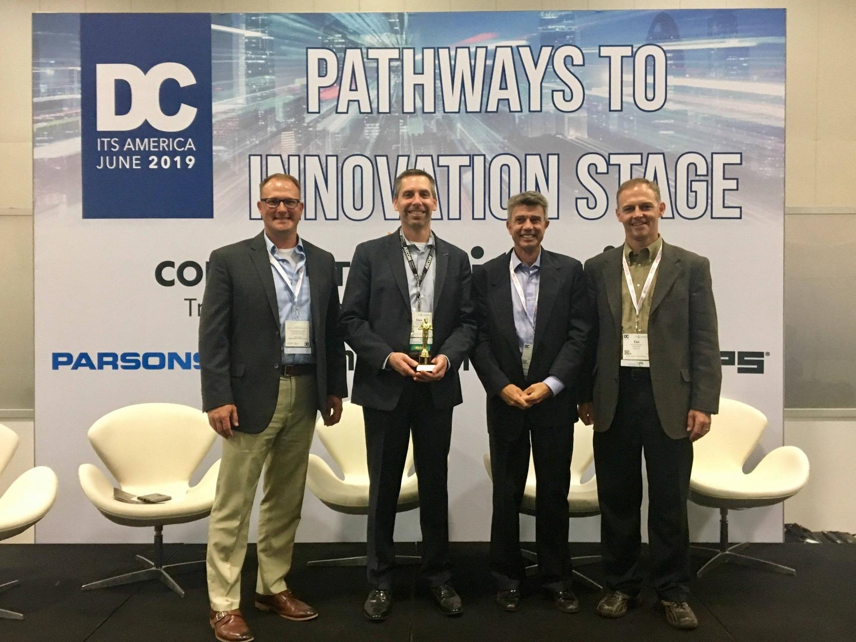 eX² Technology, Truck Specialized Parking Service (TSPS) and AECOM win the award for best Innovation Stage Presentation at the 2019 ITS America Annual Meeting. -