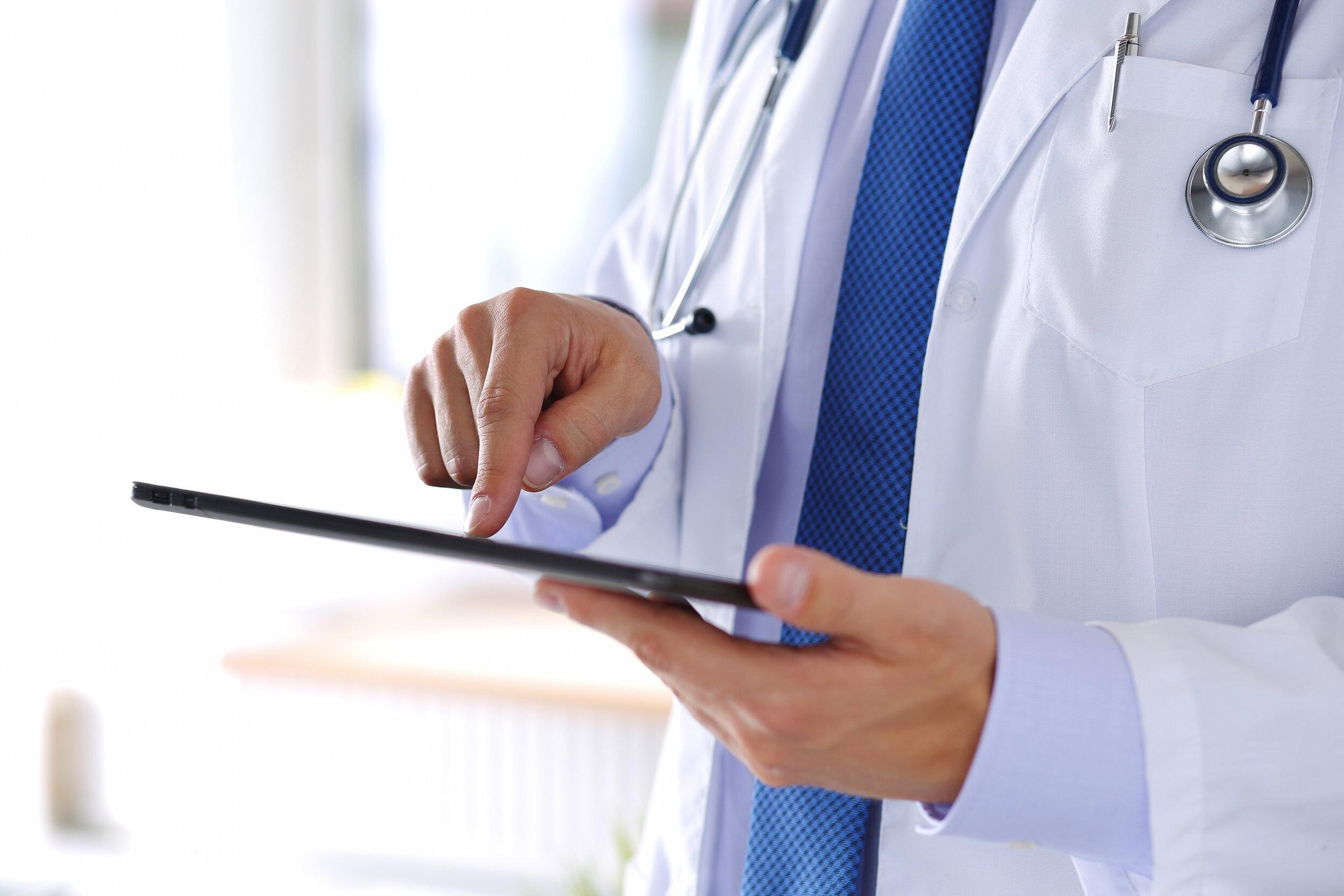 bigstock-Male-Medicine-Doctor-Holding-D-100250972.jpg