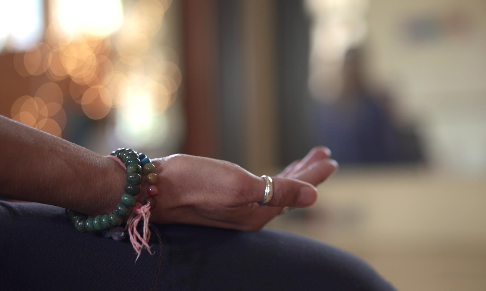 Meditation hand mala closeup YC 2016.jpg