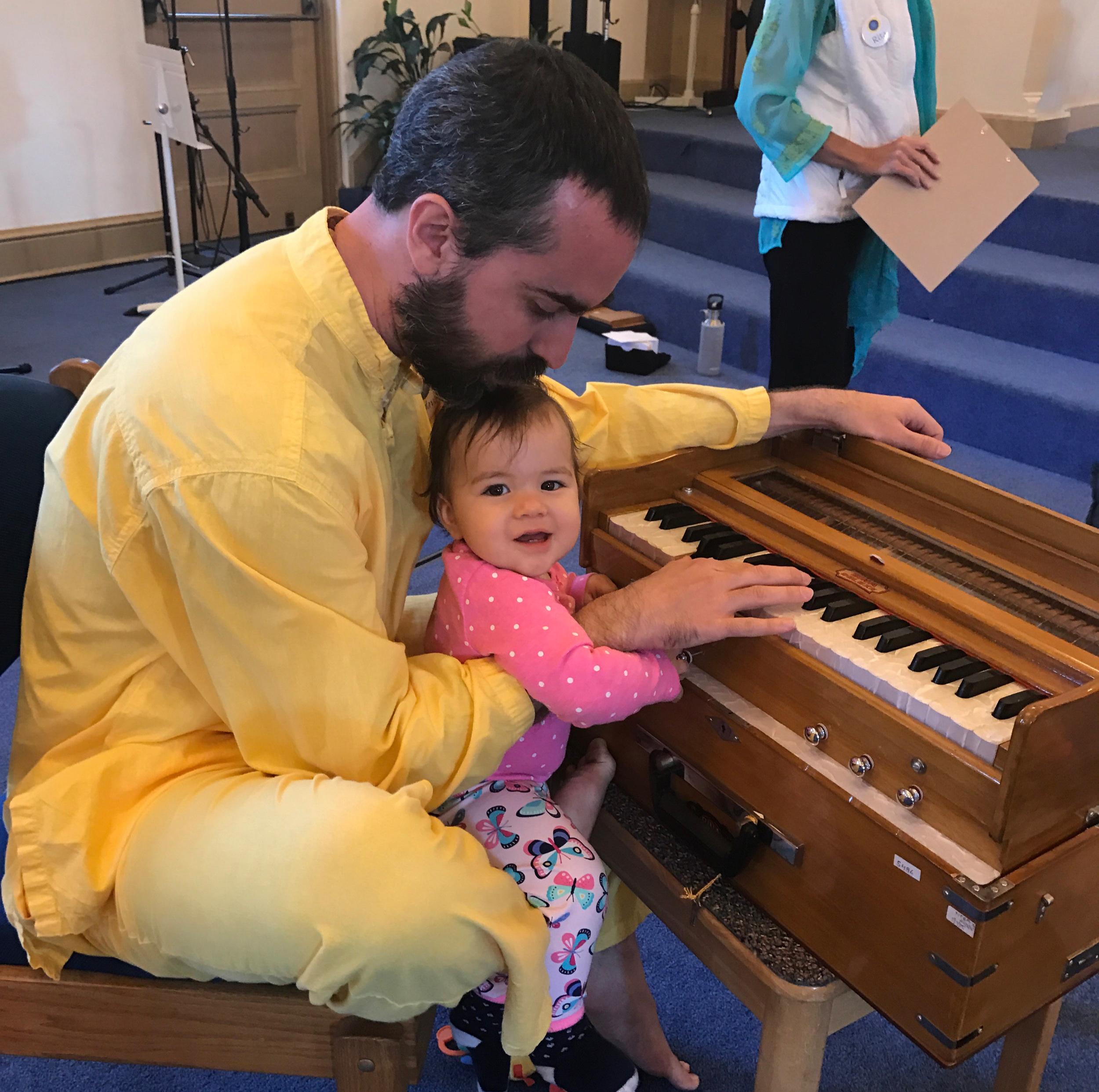 Family Service fun at the harmonium.jpg