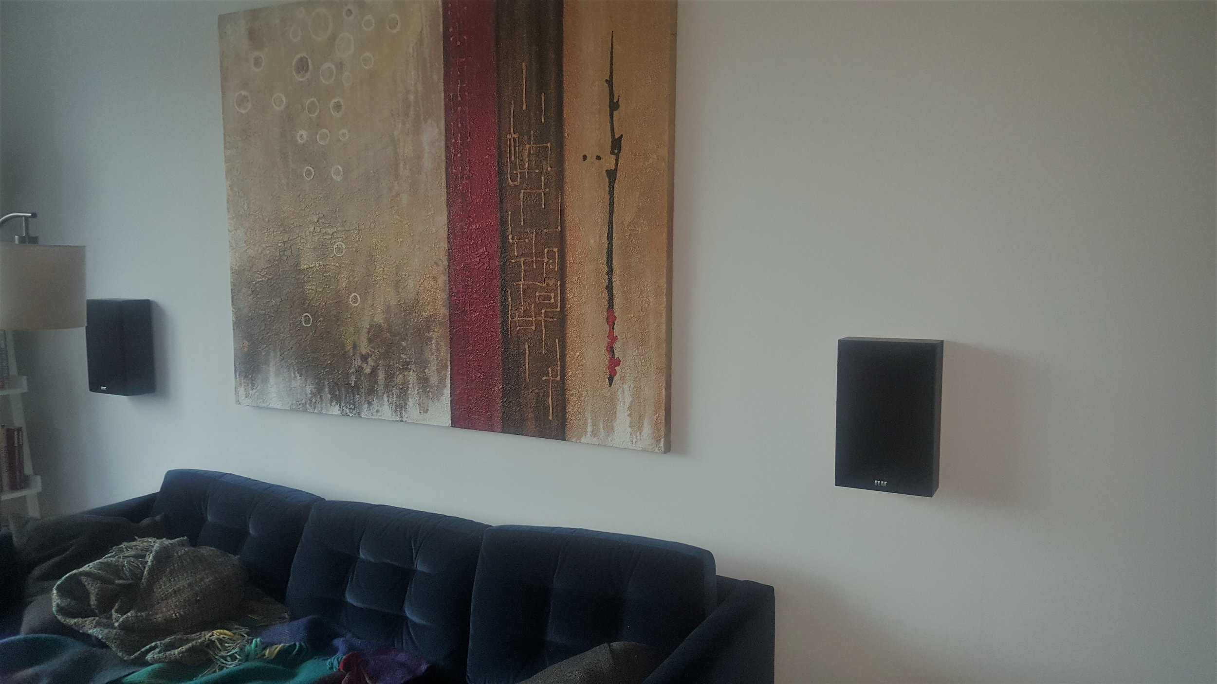 The Avalon Chrystie, Manhattan  Had to hang this painting 32 inches from the ground & then install these two Elac speakers 17 inches on each side. laser level precision because we do use a laser level.