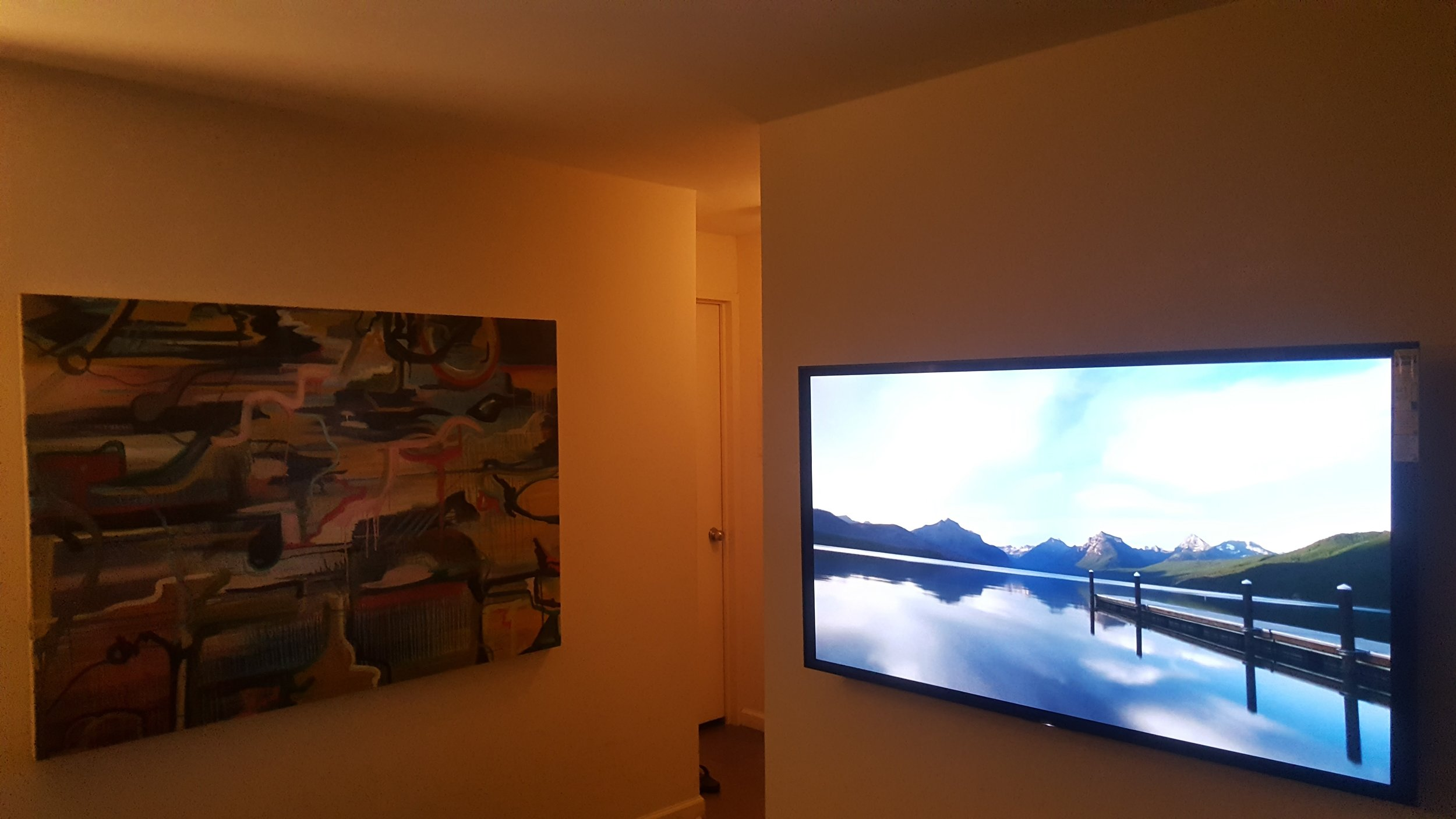 One is a painting & the other is a television, the one you think is the television might just be the painting but they do complement other.  River Place Condo