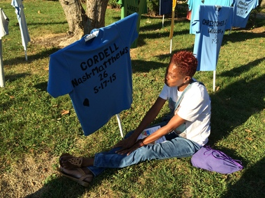 Robin Nash mourns in front of the T-shirt bearing her late son's name during a Harrisburg vigil calling for an end to gun violence on Thursday..jpg