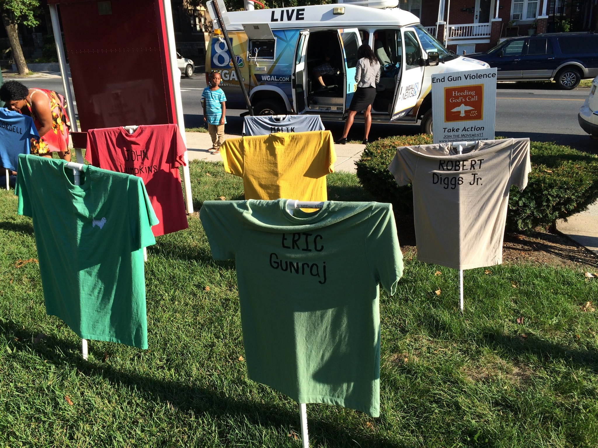 T-shirt memorial bearing the names of 72 killed by guns since 2009 served as the backdrop to a vigil calling for peace held Thursday at St. Andrews Episcopal Church in Harrisburg.jpg