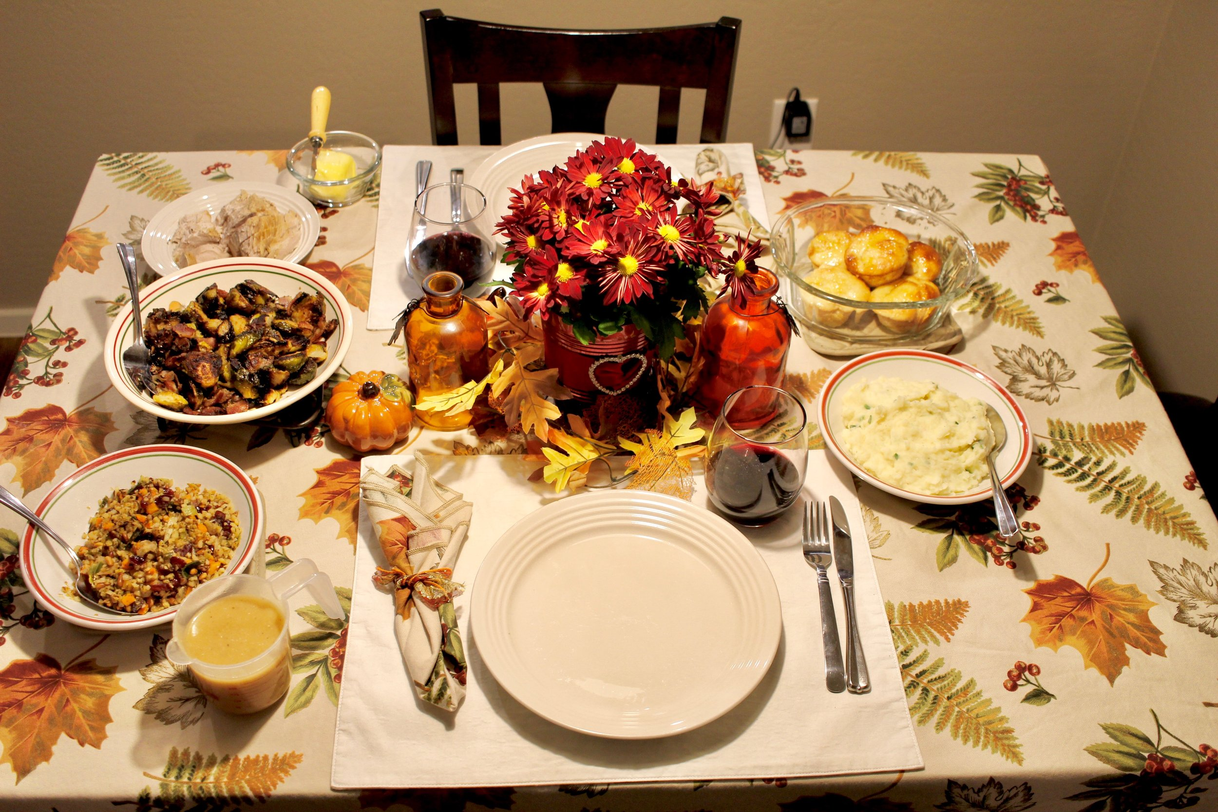 Our Thanksgiving Table Spread! Justin bought flowers on his way home from work and they looked beautiful at the center of the table.