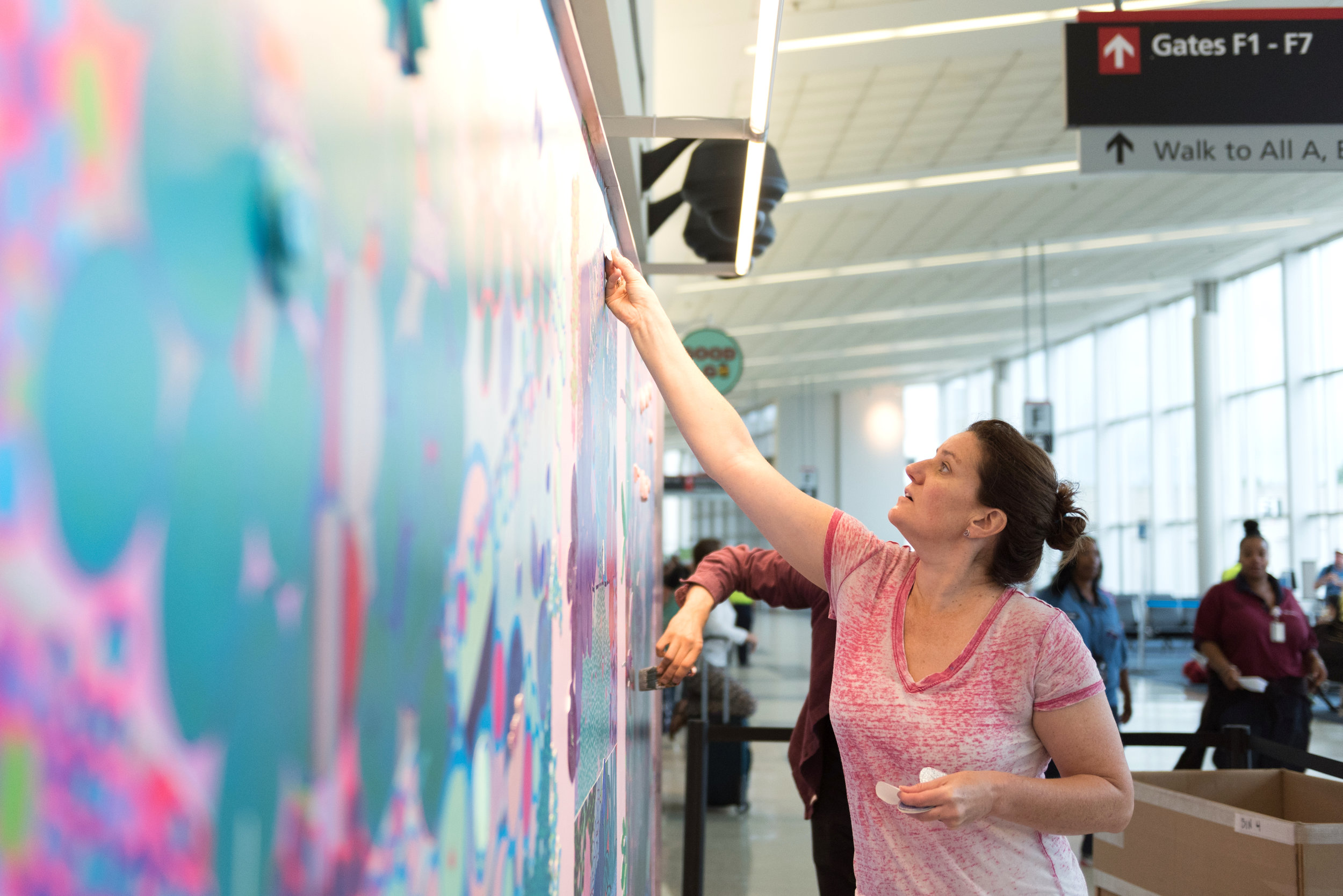 "Rebecca Jacoby installing ""Flow"" at the Philadelphia International Airport, August 2018.  Photograph courtesy of Philadelphia International Airport.    Contact me at    rebecca@rajacoby.com    for information about purchasing work or to schedule a visit to my studio at the    Crane Arts Building    in South Kensington, Philadelphia, PA, 19122."