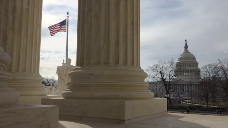 from-portico-of-us-supreme-court-building-view-us-capitol-building-home-of-the-us-congress-flag-flying_s8hdxp9de_thumbnail-full01.png