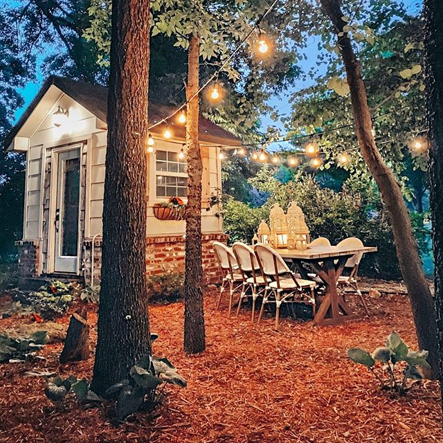 Tilly loves a cozy and inviting outdoor entertaining space and @cottonstem has knocked it out of the park! What's your favorite outdoor decor? . .  #loveyourlandscape #online #remotedesign #landscapedesign #landscape_love #backyard #yard #plantsofinstagram #greenthumb #designbeforeyoudig #outdoor #outdoorliving #outdoorentertaining #shed #lights #rustic