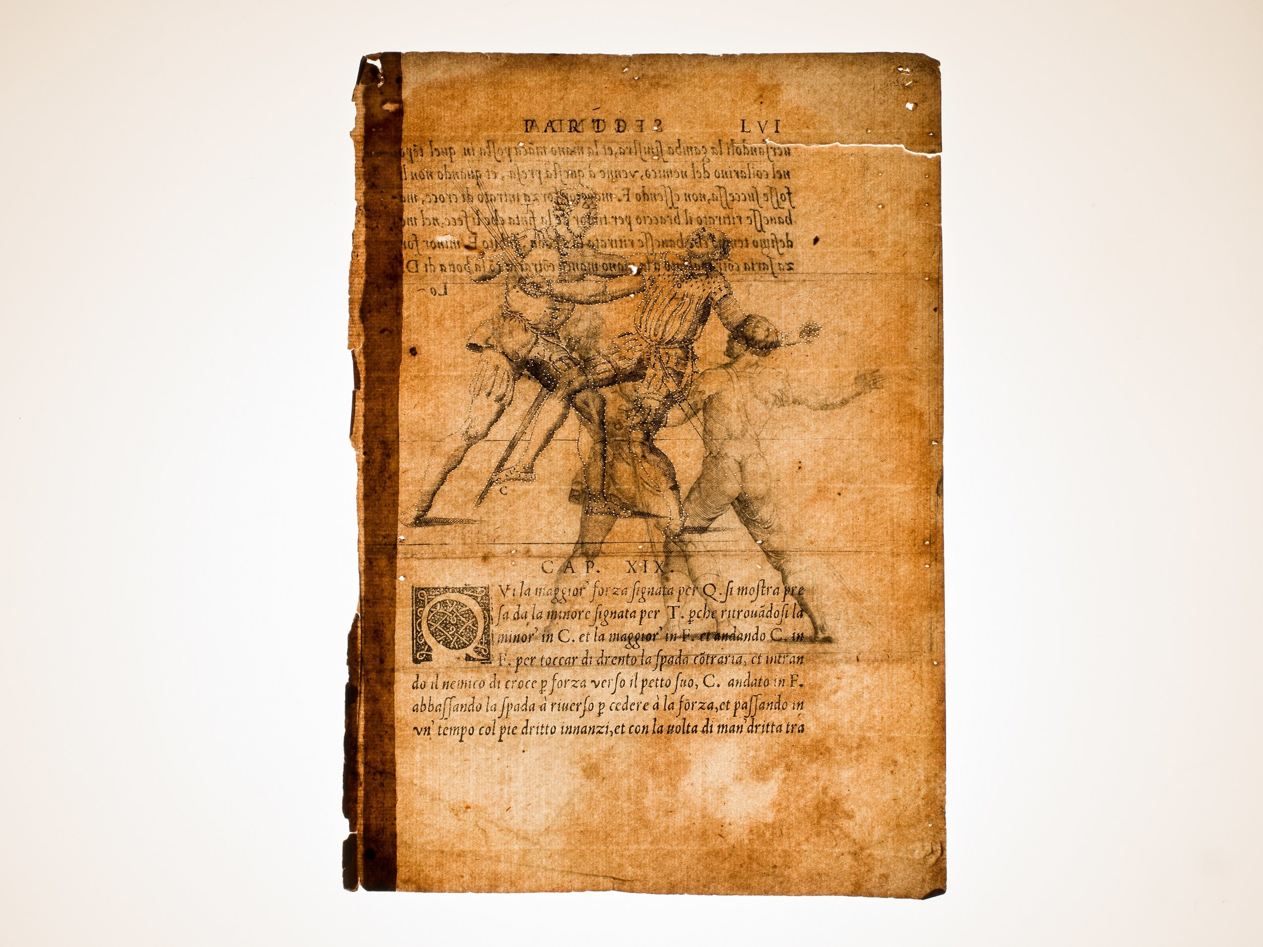 """One of the pages from Camillo Agrippa's """"Trattato di scienza d'arme"""". Rome, Antonio Blado, 1553. The page is pricked and dusted with tracing powder revealing the outline underneath as a preparatory step for the decoration of the wood."""