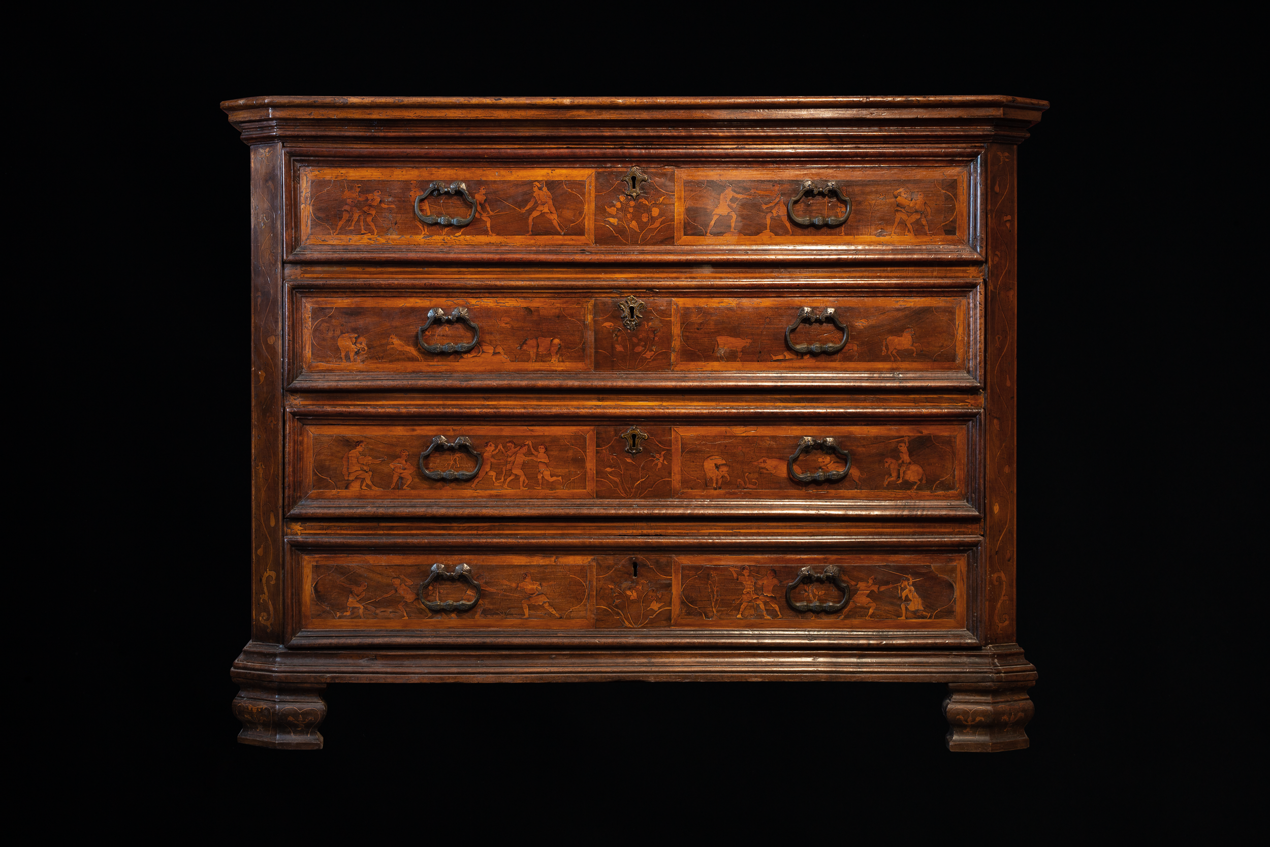 Cabinet (chest of drawers - cabinet transformable into a desk of the type 'canterano'), Lombardy, 1590-1630. Wood, briar, metal. 1439 x 1120 x 610 mm. This cabinet from a noble Milanese family is connected to the figure of the master Camillo Agrippa and his treatise. The four drawers' decoration matches the images from his fight book.