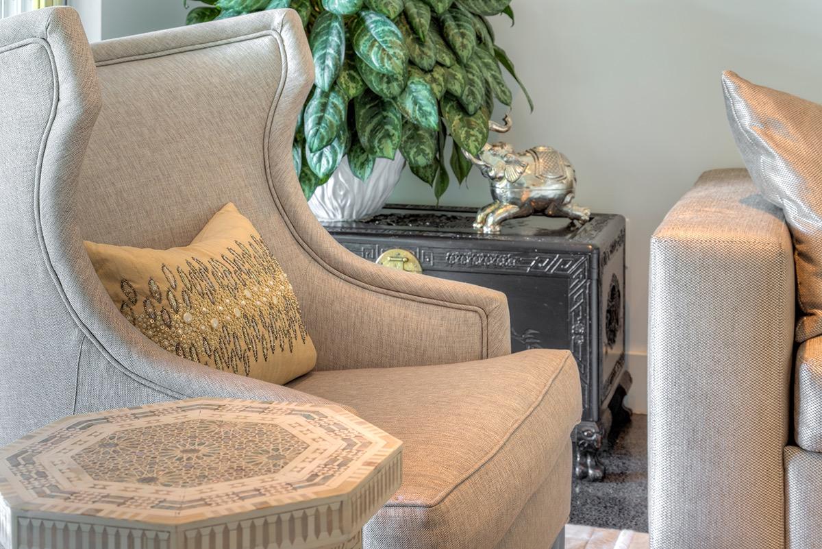 wingback-chair-custom-gray-fabric-beaded-pillows-moraccan-style-sidetable.jpg