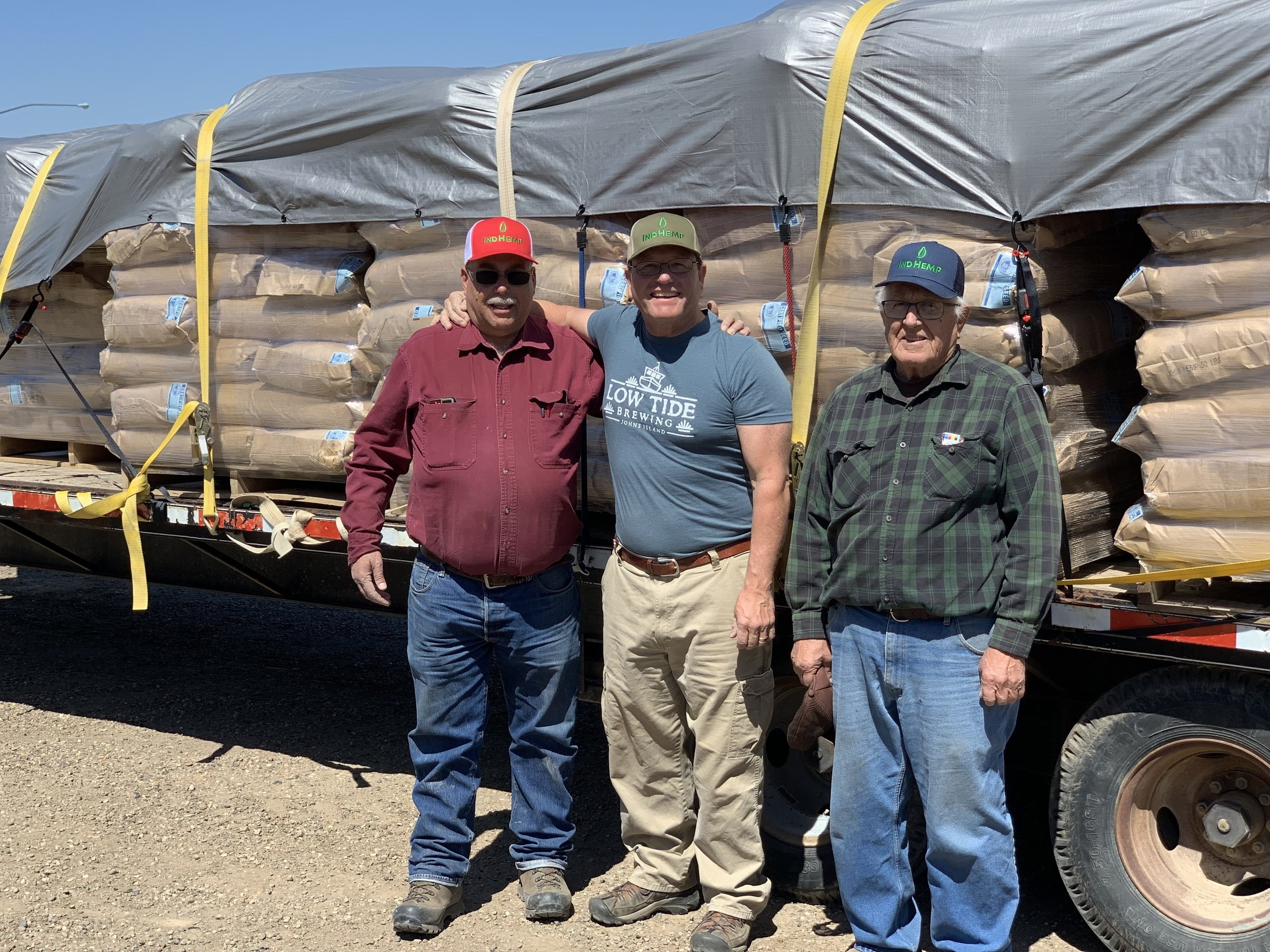Ken loading up local organic farmer Dan French with friend Norm