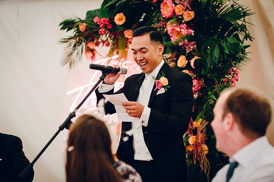 Leafy Couture - Yorkshire wedding florists - Peach and pink wedding - Bright tropical buttonholes and neon installation.jpg