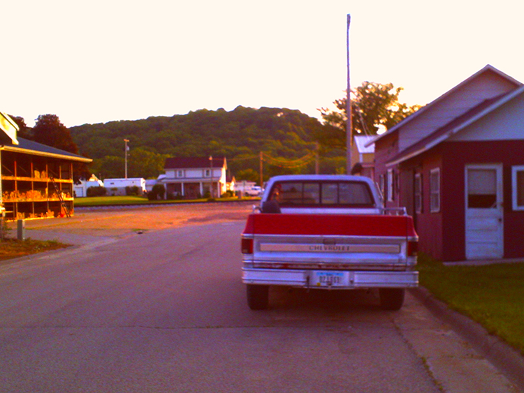 Red pickup truck on a side street. Bellevue, IA is chock-full of small-town charm