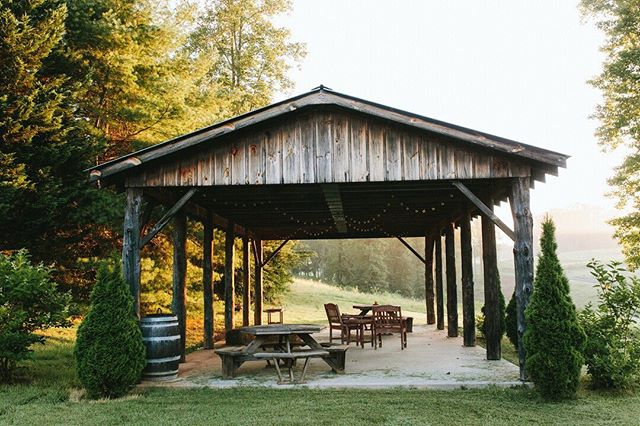 With a view of the @grassycreekwinery vineyard, our picnic pavilion is the ideal setting for an afternoon BBQ or stories over s'mores. #klondikecabins #northcarolina