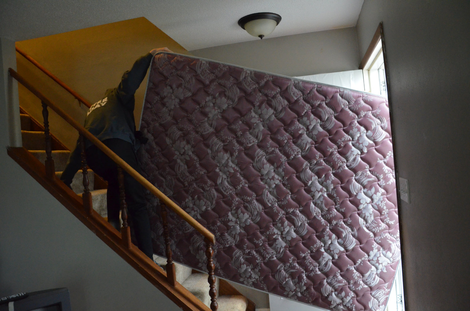 Mattress up the stairs 12:2:18.jpg