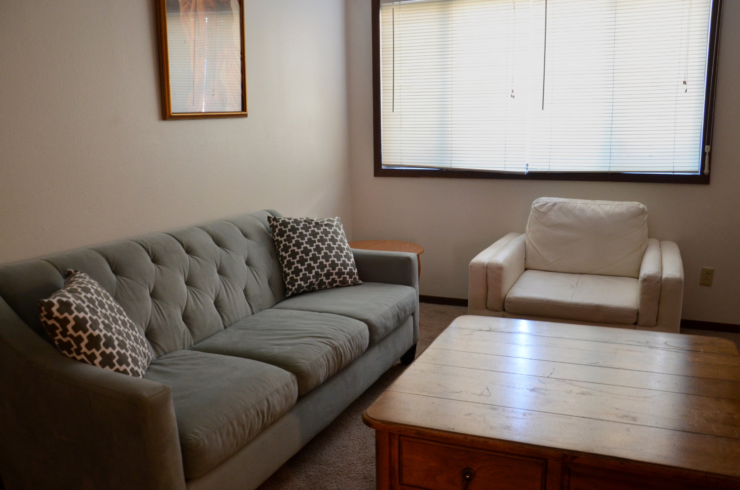 Beautiful donated couch, chair, and coffee table perfect for this space