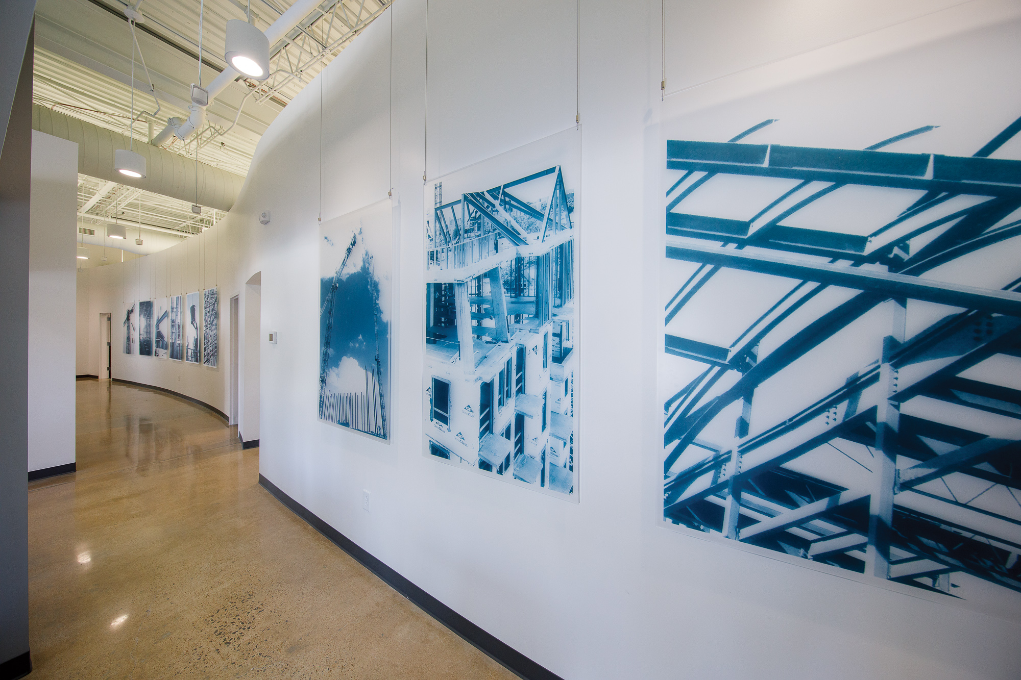 Large format project graphics printed on acrylic and suspended from overhead framework
