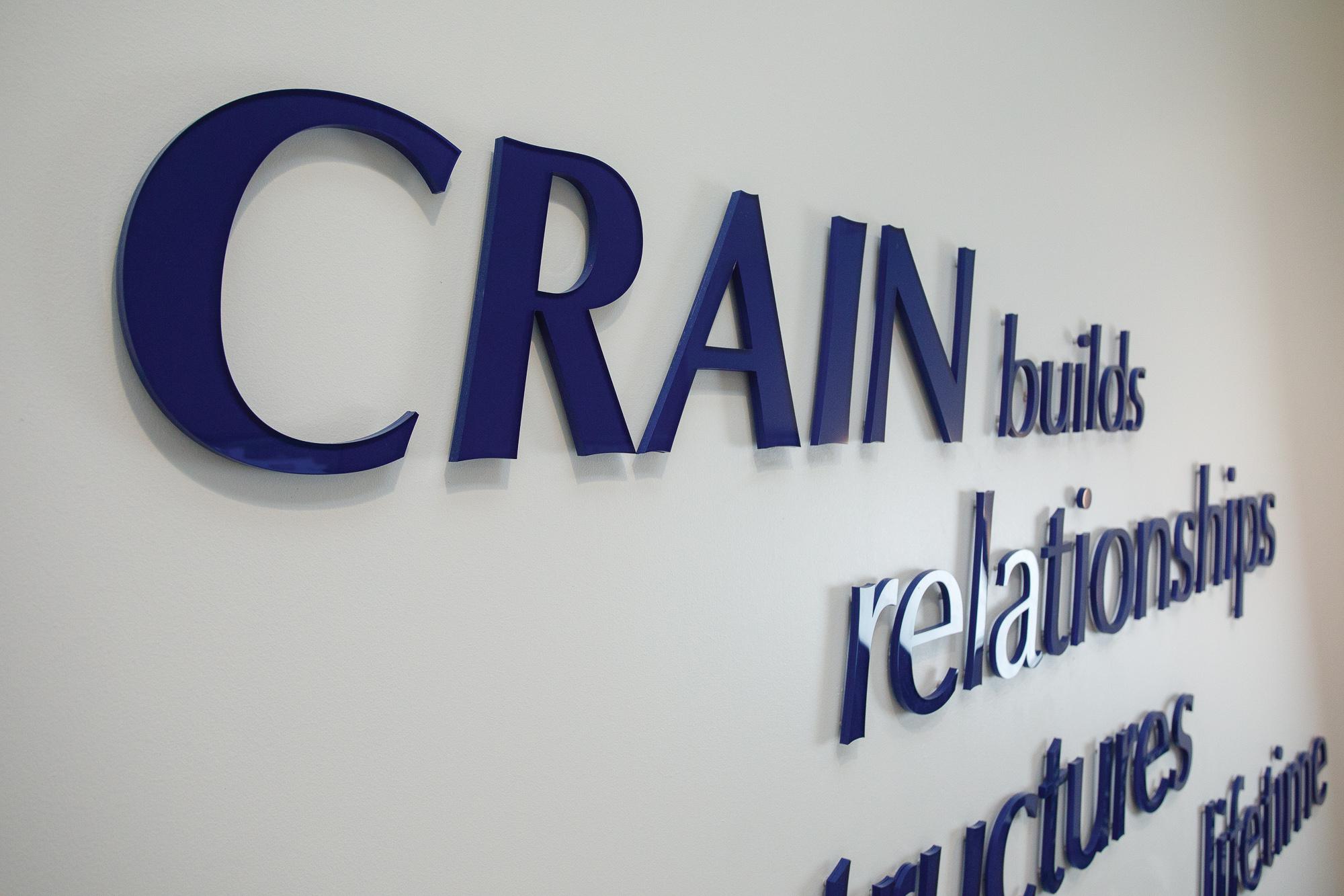 Crain Construction_Brand Identity Signage_Lobby Wall_Acrylic letters_MG_8003_small 2000 px.jpg