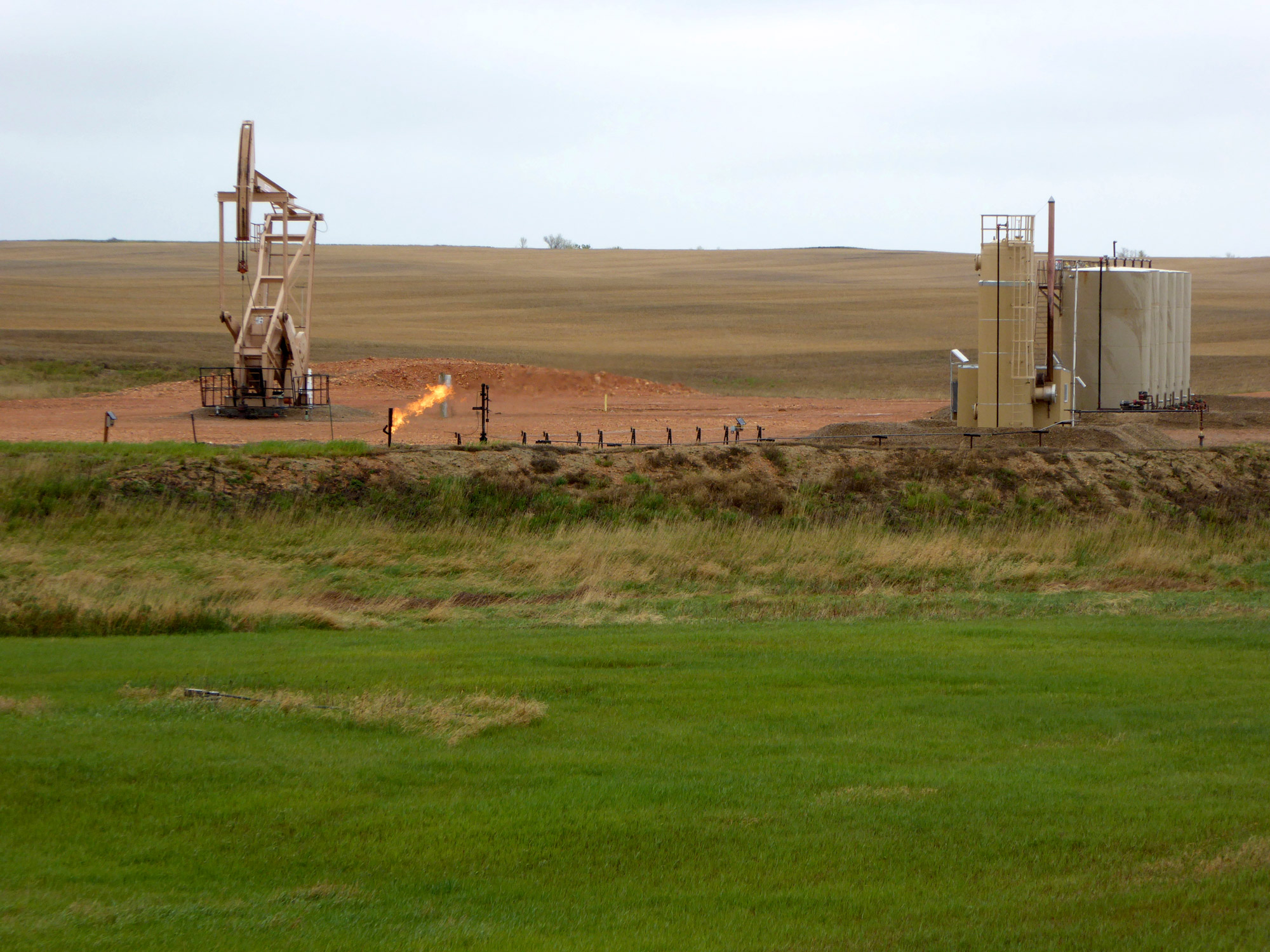 Excess natural gas is flared at a well pad in McKenzie County, ND
