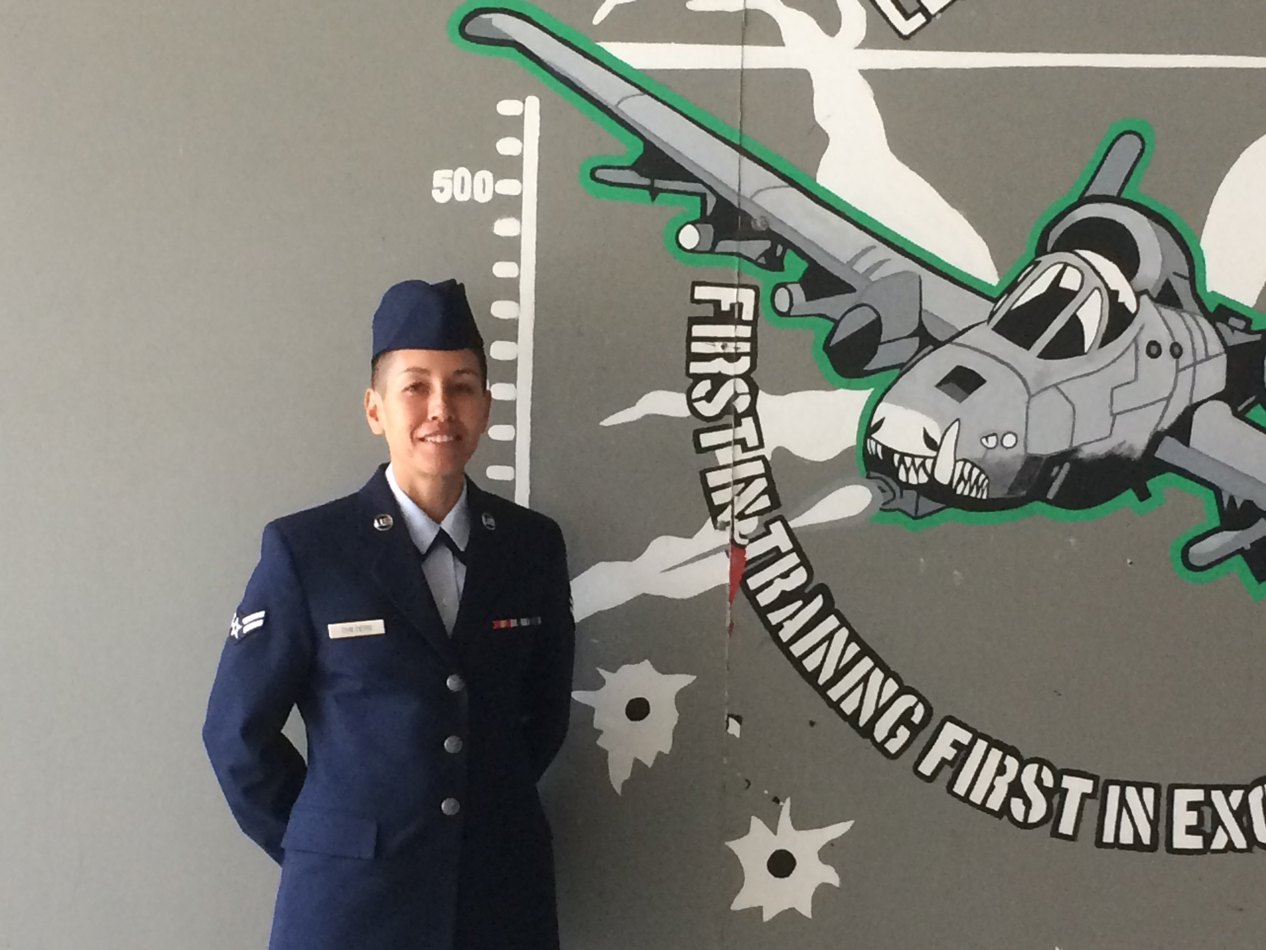 My sister Jennifer on her graduation day from the Air National Guard.