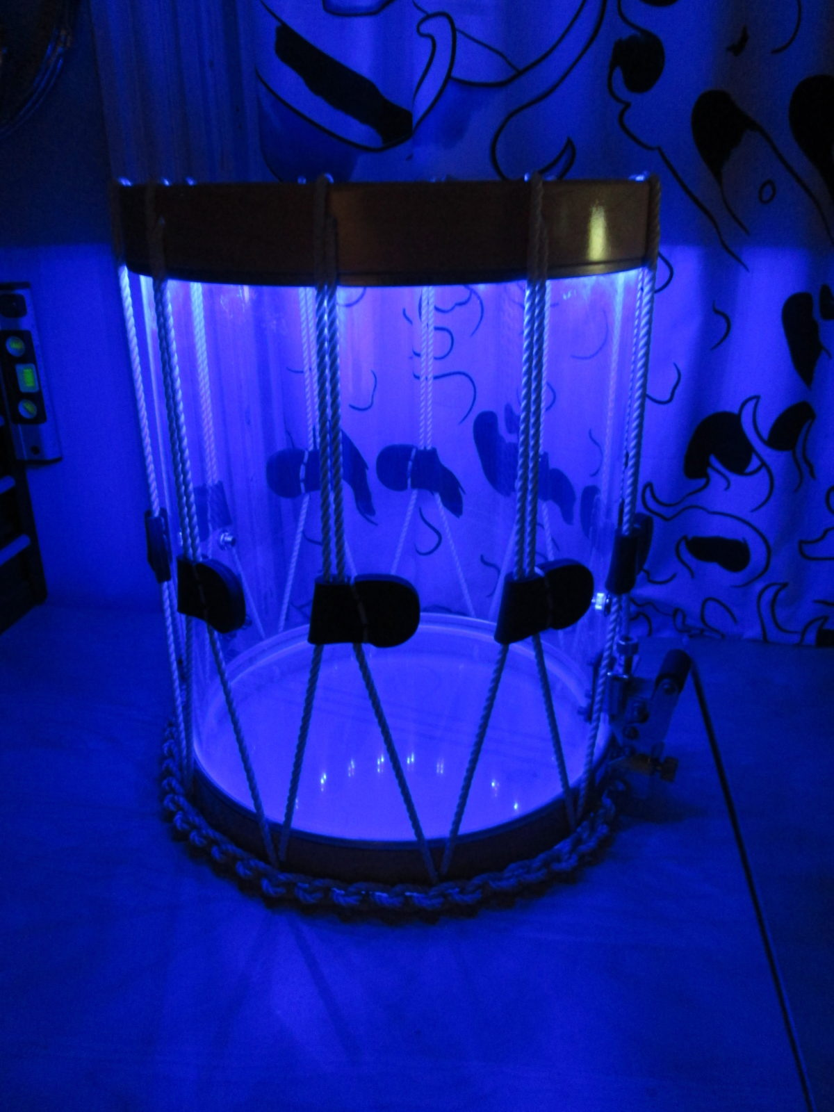 LED-imbued acrylic rope tension drum