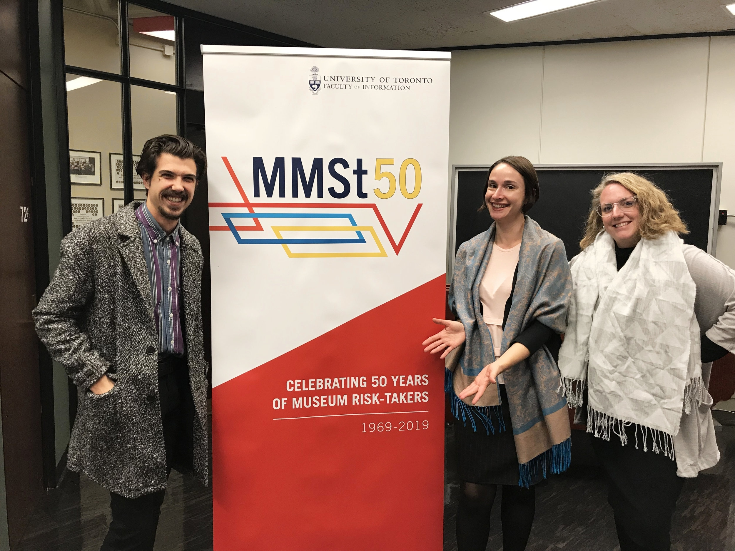First reveal of the MMSt50 banner with MMSt student Jordan Fee, Prof. Irina Mihalache and MMSt alumna Melissa Smith