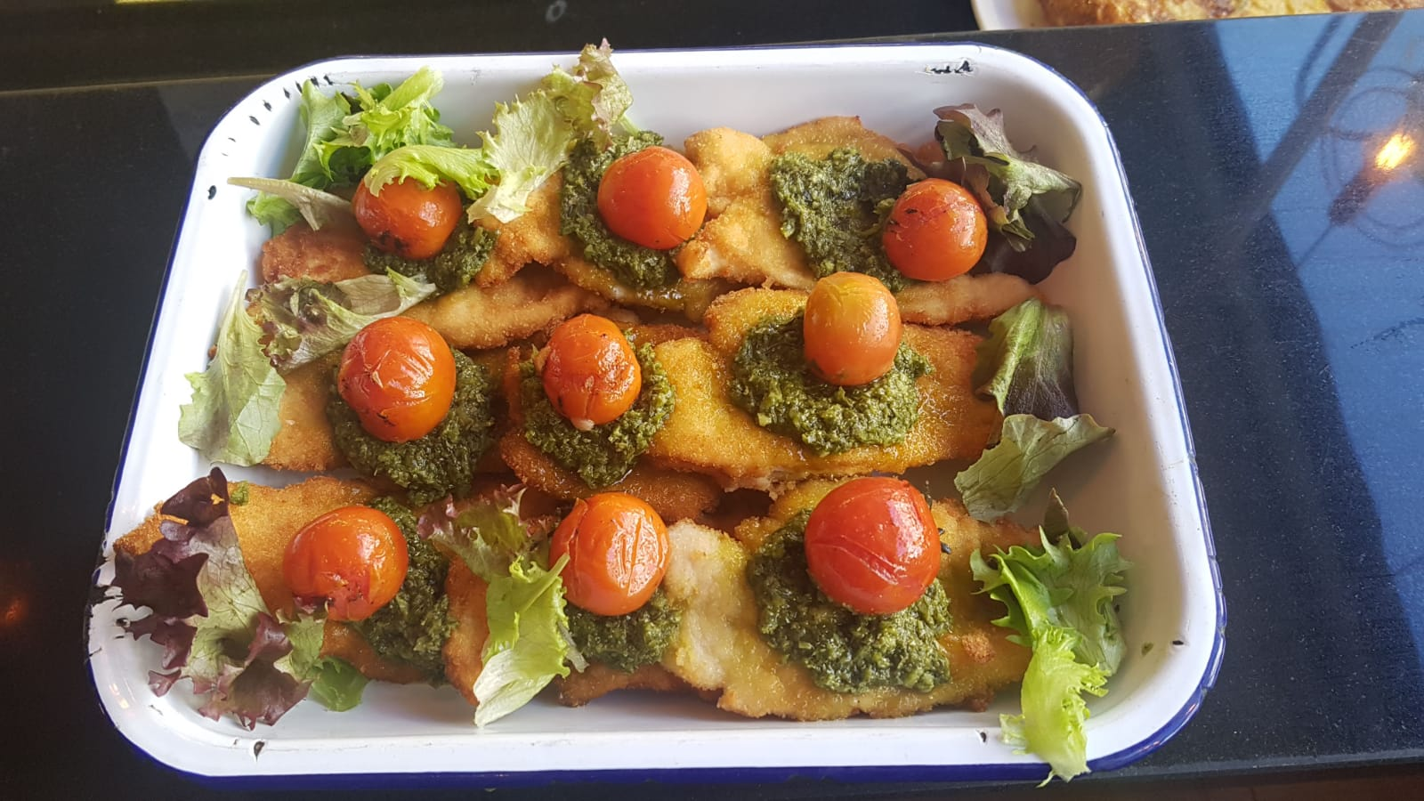 Counter Main Meal is different every day - these are chicken escalopes with pesto and tomato.