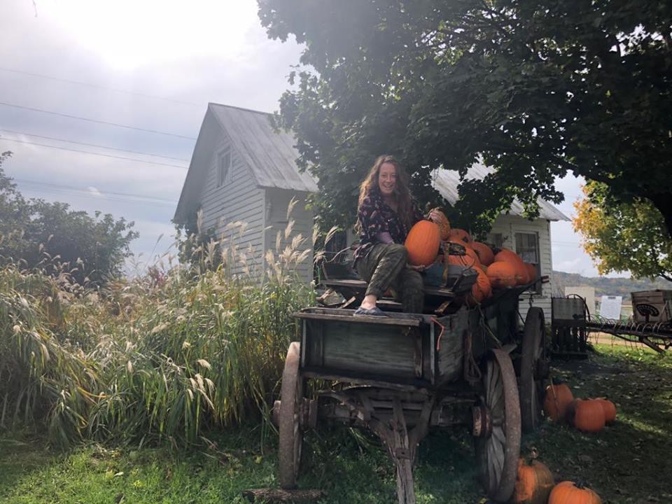 Kels and a pumpkin.jpg