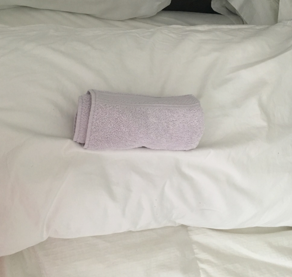 Place rolled towel on pillow, under your neck