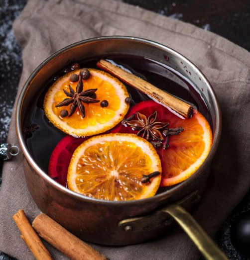 Mulled Wine - 10 whole cloves2 whole star anise2 cinnamon quills2 bay leaves1 orange or 2 mandarins, finely sliced2 cups apple juice1 cup caster/superfine sugar1 tsp vanilla extract2 bottles red wine, such as merlot½ cup orange liqueur (optional)Bring all ingredients except wine and liqueur to a simmer in a large pot, stirring until sugar has dissolved (about 15 minutes).Add wine and liqueur, reduce heat to low and allow to warm through without boiling (5-10 minutes). Strain off fruit, spices and bay leaves if desired, or leave them in the mix. Serve hot and enjoy!