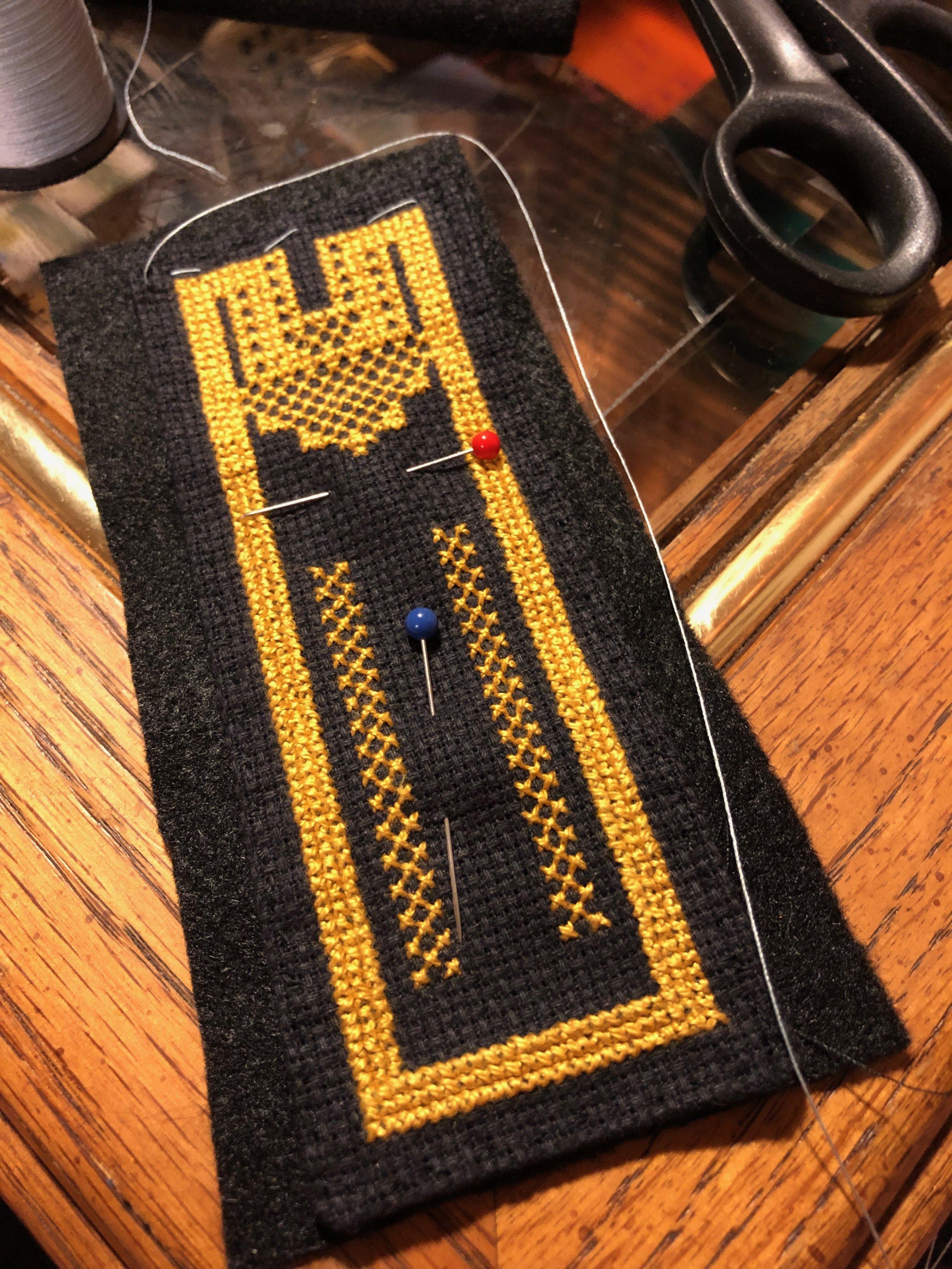 Pinned black felt on black Aida cloth
