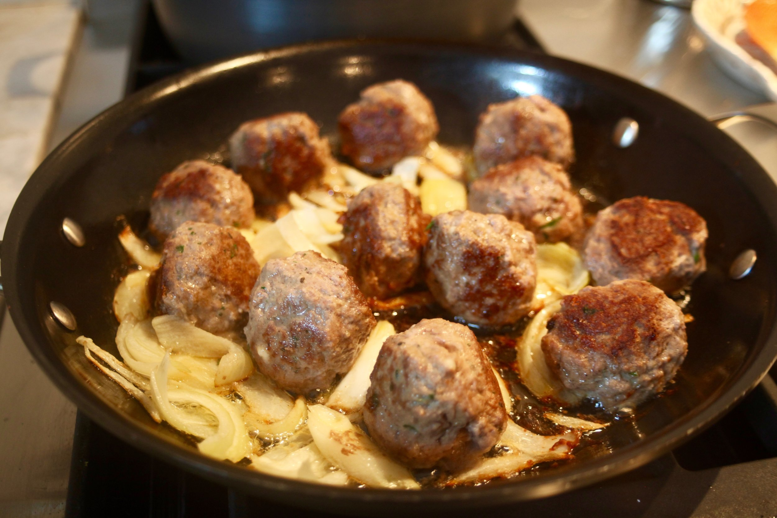 Meatballs and onion cooking up