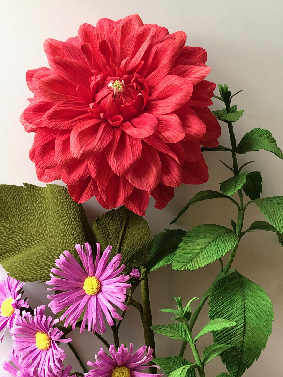 Crepe paper dahlia, asters, and mint by Inga Ilze Peterson