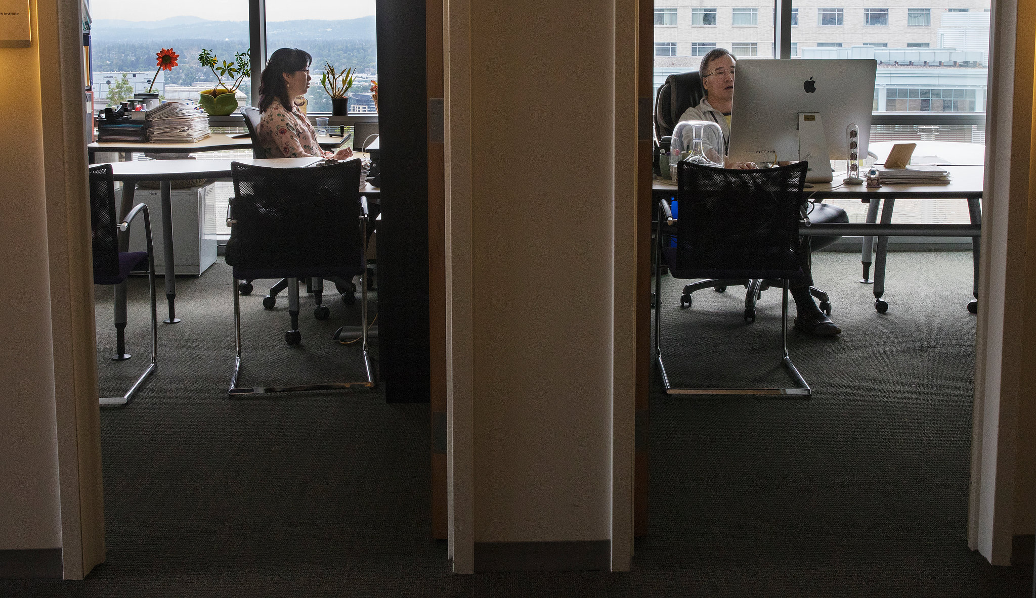 Soo-Kyung, left, and Jae, right, work next door to each other; together they are researching FOXG1 syndrome, the rare disorder Yuna has.CreditRuth Fremson/The New York Times