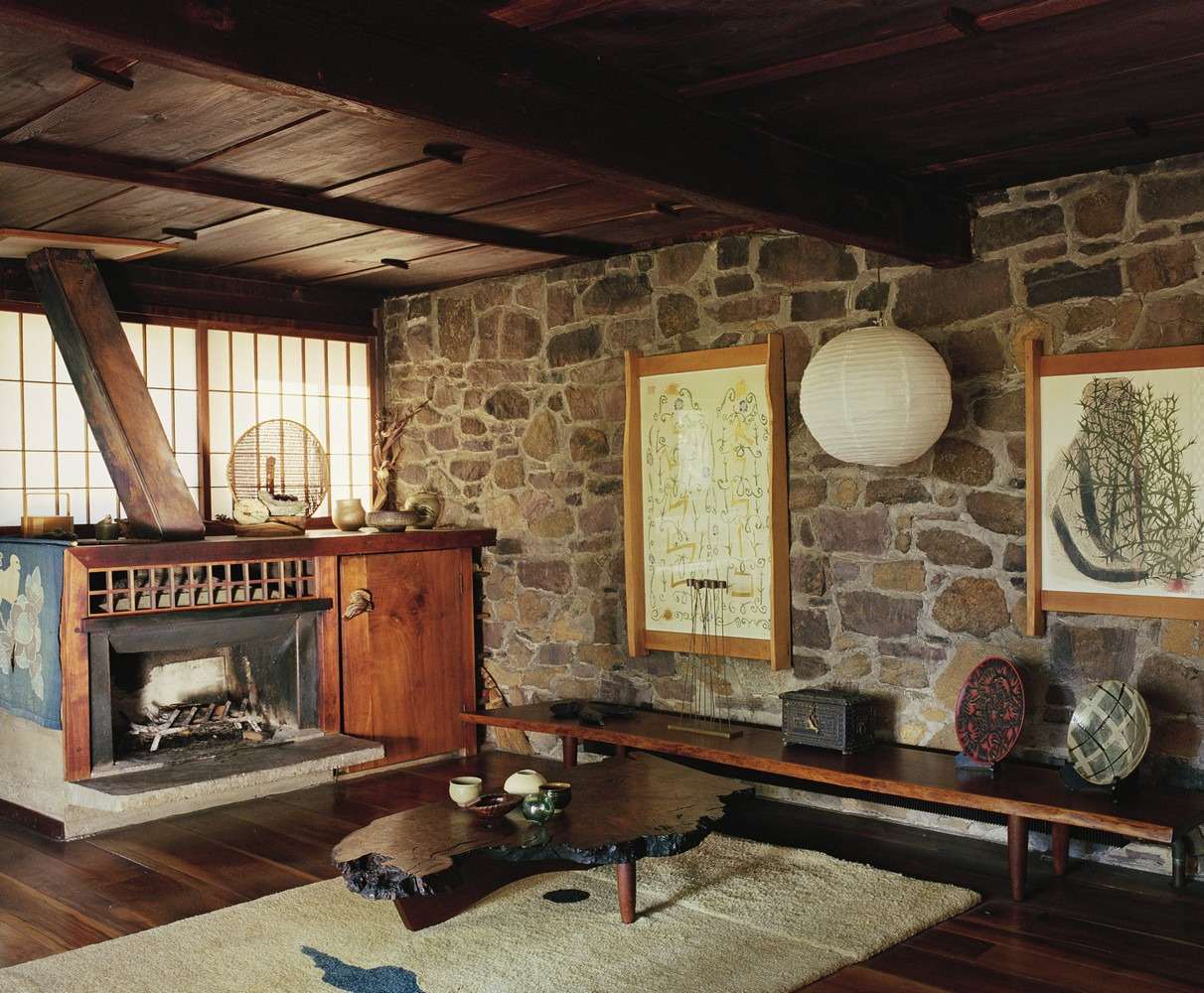 The living room of the main house, with late '60s Conoid table, Turned-Leg bench, and custom fireplace cabinet.